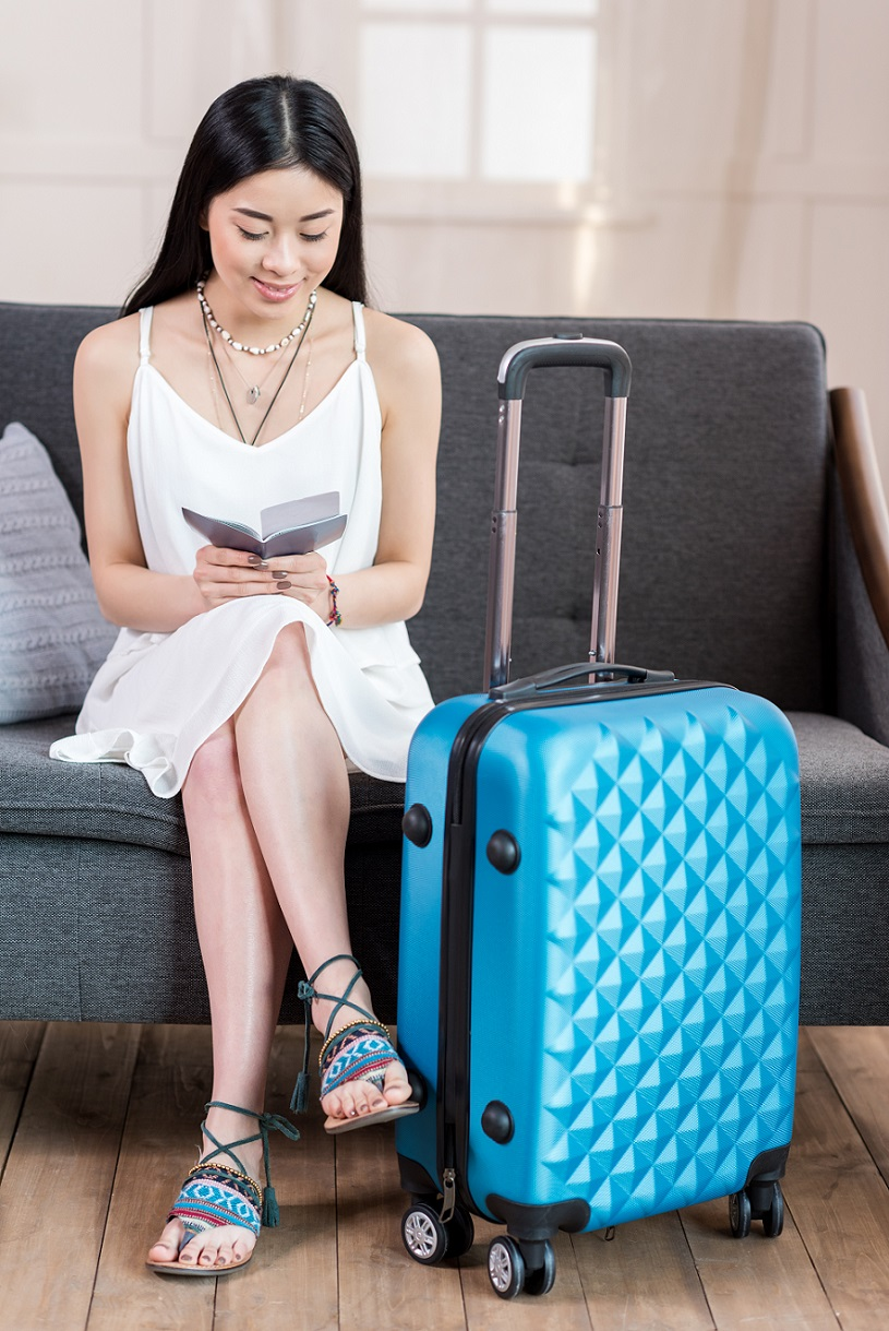 A tourist with suitcase is ready for the trip