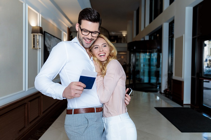 Happy couple holding passport at a hotel in Vietnam