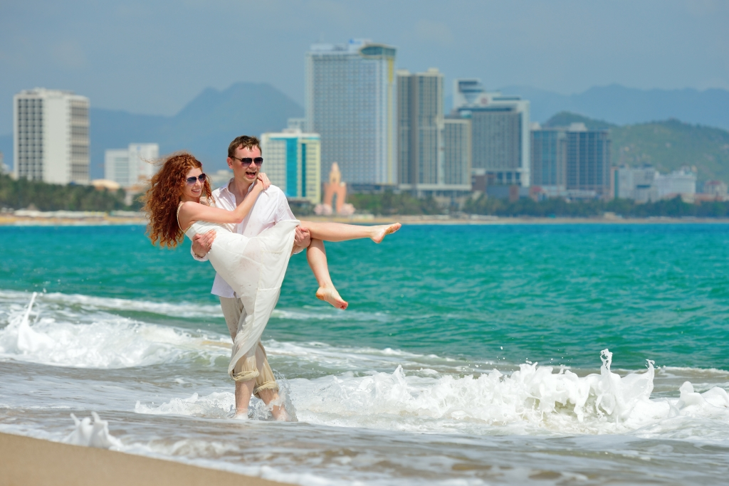 Happy couple on the beach of Nha Trang